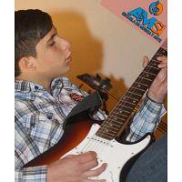 Aprende a tocar Guitarra Acústica y Eléctrica - Amsi Escuela.
